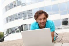 Studente di college con il calcolatore Immagine Stock Libera da Diritti