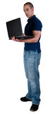 Studente di college con il calcolatore del taccuino Fotografia Stock