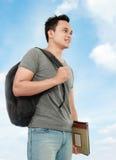 Studente di college con il libro ed il sacchetto Immagine Stock Libera da Diritti