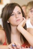 Studente di college femminile che ascolta una conferenza Fotografia Stock Libera da Diritti