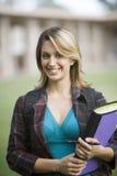 Studente di college femminile con il libro Fotografia Stock Libera da Diritti