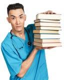 Studente di medicina con i libri Fotografia Stock