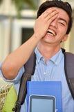 Studente di minoranza dell'università Laughing immagine stock