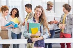 Studente di modo che sorride alla macchina fotografica Fotografia Stock Libera da Diritti