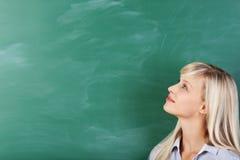 Studente di pensiero biondo Immagine Stock