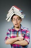Studente divertente con molti libri Fotografie Stock