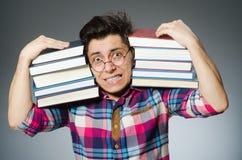 Studente divertente con molti libri Immagine Stock Libera da Diritti