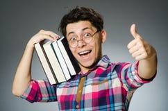 Studente divertente con molti libri Fotografia Stock