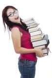 Studente emozionante che tiene molti libri Immagini Stock