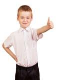 Studente europeo del ragazzo nel sorridere dei pantaloni e della camicia isolato su bianco Immagini Stock