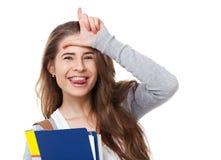 Studente felice che mostra L segno isolato Fotografie Stock