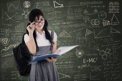 Studente femminile della High School a classe Immagini Stock Libere da Diritti