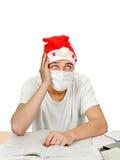 Studente malato in Santa Hat Fotografie Stock Libere da Diritti
