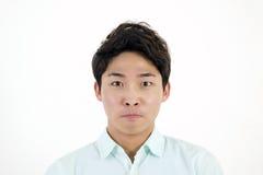 Studente maschio asiatico aggrottante le sopracciglia Immagini Stock