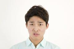 Studente maschio asiatico arrabbiato Fotografie Stock Libere da Diritti