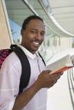 Studente maschio With Book Fotografie Stock Libere da Diritti