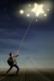 Studente maschio che tira le stelle Fotografia Stock Libera da Diritti