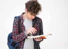 Studente maschio con la penna ed il blocco note Fotografie Stock