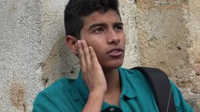 Studente maschio teenager confuso Fotografia Stock
