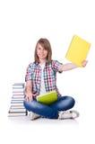 Studente sorridente con i libri isolati su bianco Fotografia Stock