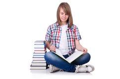 Studente sorridente con i libri isolati su bianco Fotografie Stock