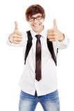 Studente sorridente con i pollici su Fotografie Stock