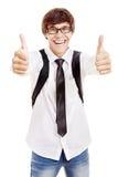 Studente sorridente con i pollici su Immagini Stock Libere da Diritti