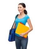 Studente sorridente con la borsa e le cartelle Fotografia Stock