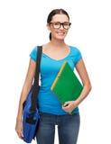 Studente sorridente con la borsa e le cartelle Immagine Stock