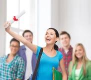 Studente sorridente con la borsa e le cartelle Fotografia Stock Libera da Diritti