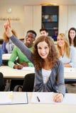 Studente diligente che solleva mano Fotografia Stock Libera da Diritti