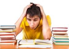 Studente stanco con libri Immagine Stock Libera da Diritti