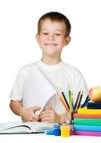 Studente sveglio del ragazzo con i libri e le matite Immagine Stock Libera da Diritti