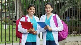 Studente sveglio di professione d'infermiera del giovanotto Immagine Stock