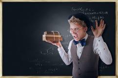 Studente terribile di grido con i libri Fotografia Stock