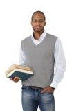 Studente universitario astuto con i libri Immagine Stock Libera da Diritti