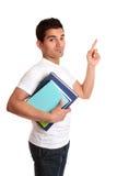 Studente universitario che indica la sua barretta Fotografia Stock Libera da Diritti