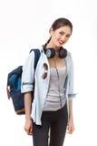 Studente universitario isolato su priorità bassa bianca Studenti caucasici asiatici della giovane donna Fotografia Stock