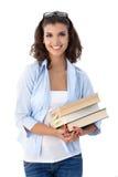 Studente universitario sorridente con i libri Immagini Stock