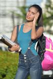 Studente Wondering With Notebooks royalty-vrije stock afbeelding