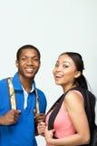Studenten die Rugzakken dragen - Verticaal Royalty-vrije Stock Afbeelding
