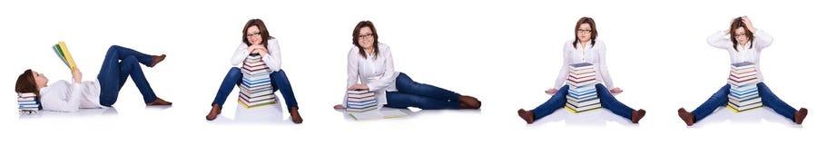 Studenten med böcker som isoleras på vit Royaltyfri Foto