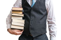 Studenten rymmer många böcker i händer bakgrund isolerad white Fotografering för Bildbyråer