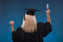 Studentenmädchen auf blauem Hintergrund Lizenzfreie Stockfotografie