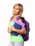 Studentenmeisje met rugzak en geïsoleerde boeken stock foto's
