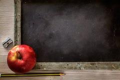 Studentenversorgungen mit Apfel Lizenzfreies Stockbild