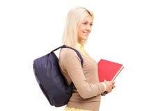 Studentessa con i libri della tenuta della borsa Immagini Stock