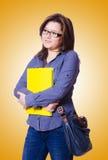 Studentessa con i libri su bianco Fotografie Stock Libere da Diritti