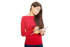 Studentessa con il taccuino Immagine Stock