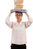 Studentessa coreana con i manuali sulla testa Immagine Stock